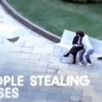 people stealing kisses
