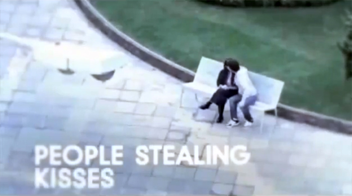 people stealing kisses