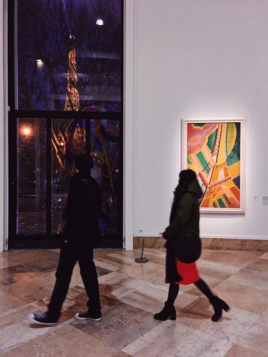 """""""Eiffel, Eiffel"""" - photo taken @ Musée d'Art Moderne de la Ville de Paris (December 2017) by Elena Mazzoni Wagner.   The painting on the right is """"La Tour Eiffel"""" (1926) by Robert Delaunay."""